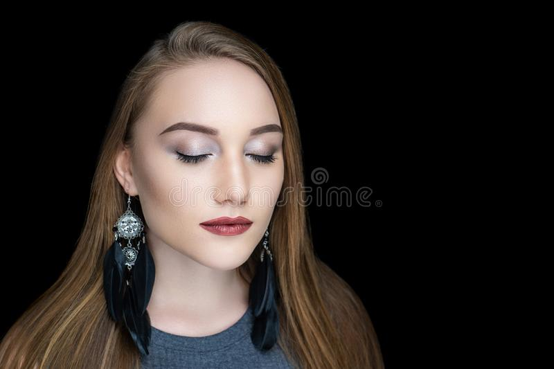 Girl black feathers earrings royalty free stock photo