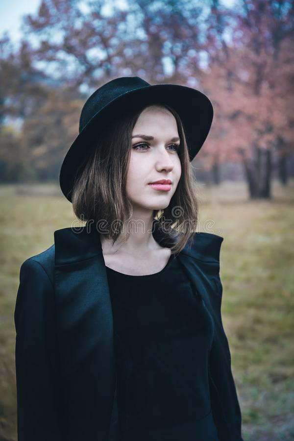 Girl in a black hat stock photography