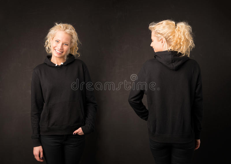 Girl in black hoodie from front and back royalty free stock image