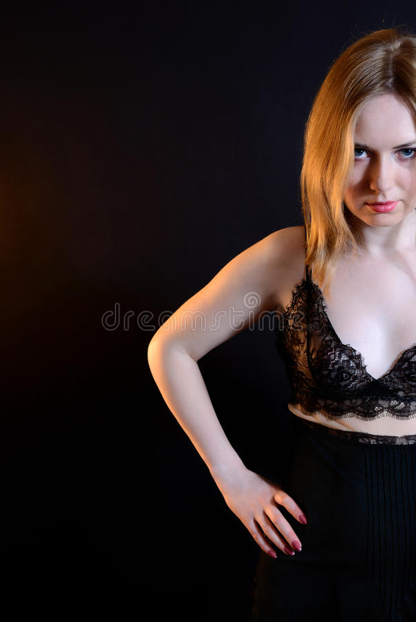 Download The Girl In A Black Night Dress Looks Frowningly Royalty Free Stock Image - Image: 24845616