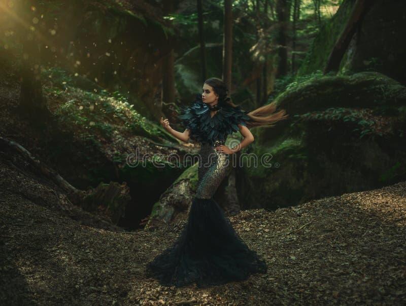 Girl - black raven royalty free stock image