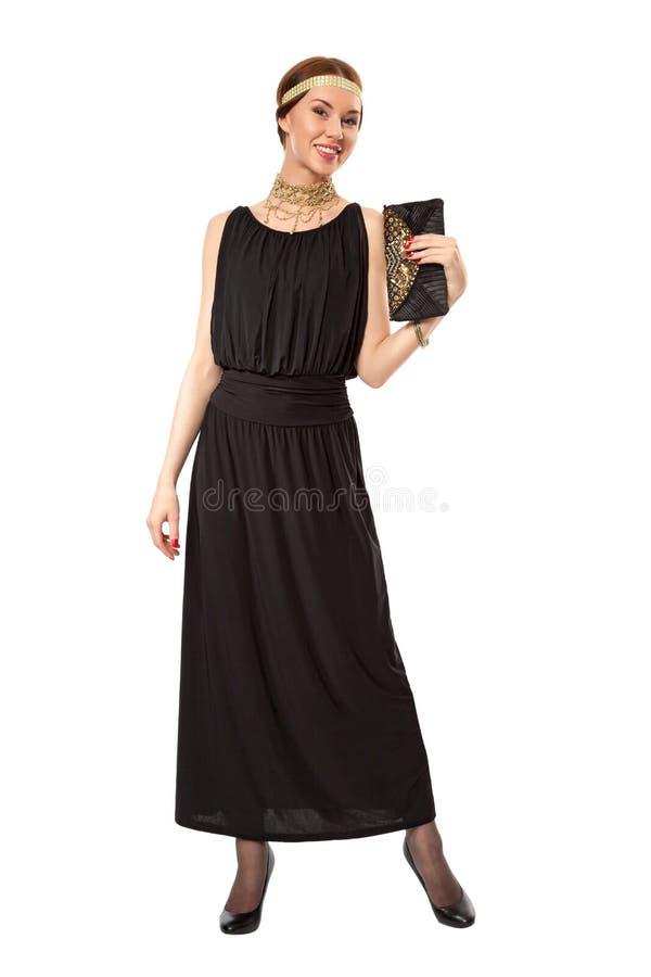 Girl in a black retro dress stock photo