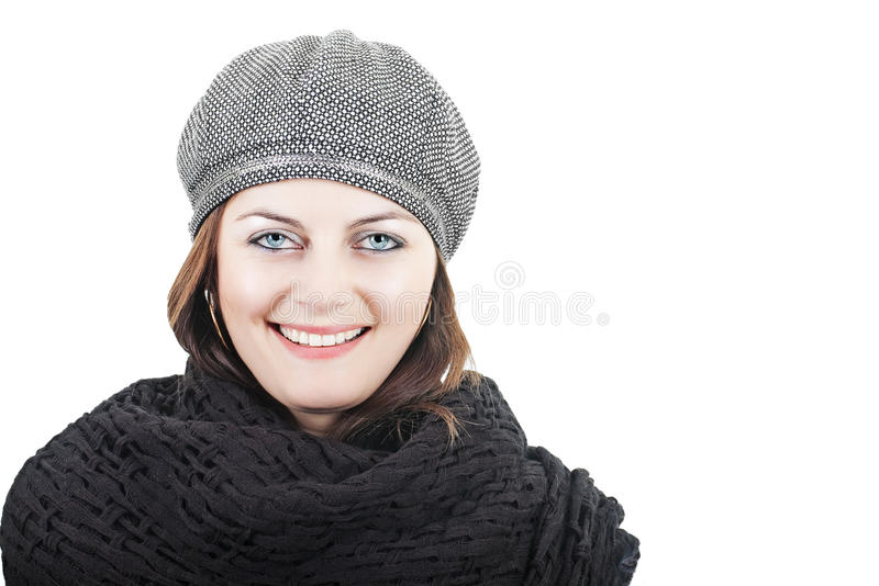 Girl in black scarf and hat. Stylish smiling young woman in grey hat and knitted black scarf isolated on white with copy space stock photo