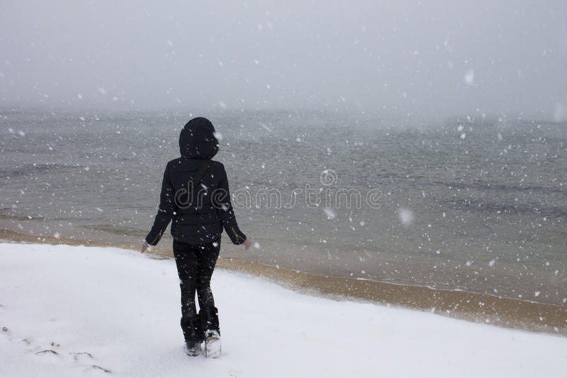 Girl on the Black Sea in the snow stock images