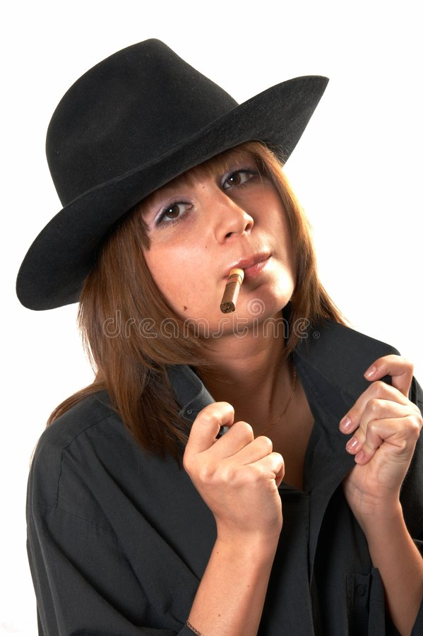 Girl in a black shirt and a cowboy's hat royalty free stock photography