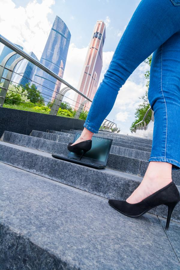 girl black shoes with a heel steps and attack the notebook royalty free stock images
