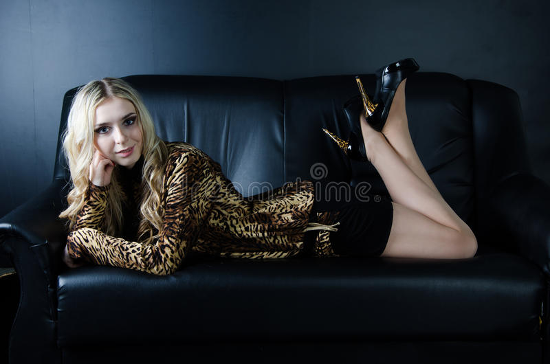 Girl On A Black Sofa Royalty Free Stock Image