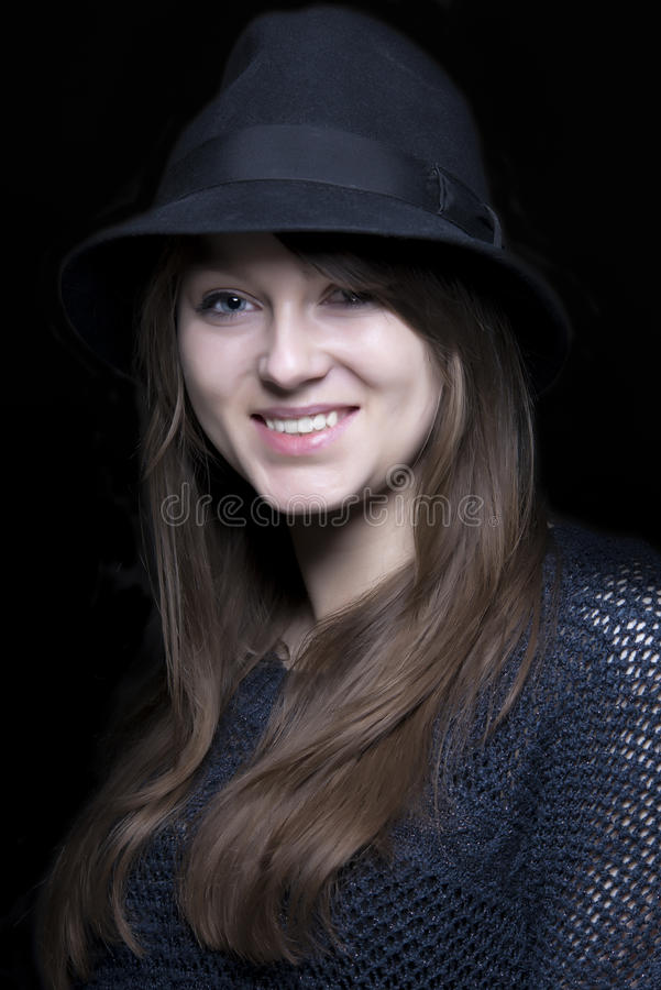 Girl portrait in black with stylish black hat royalty free stock images