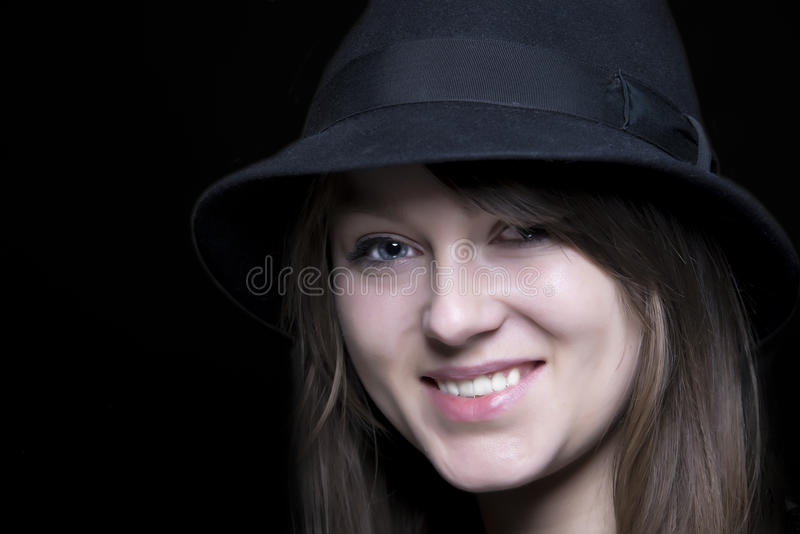 Girl in black with stylish black hat stock photo