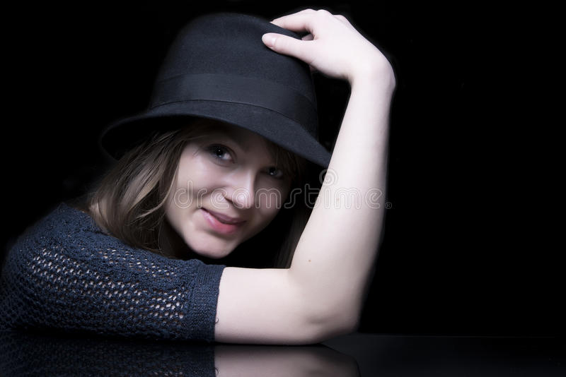 Portrait of lady in black with stylish black hat royalty free stock images