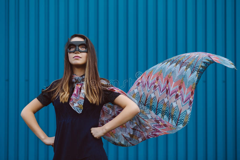 Girl in black superhero mask stock photography