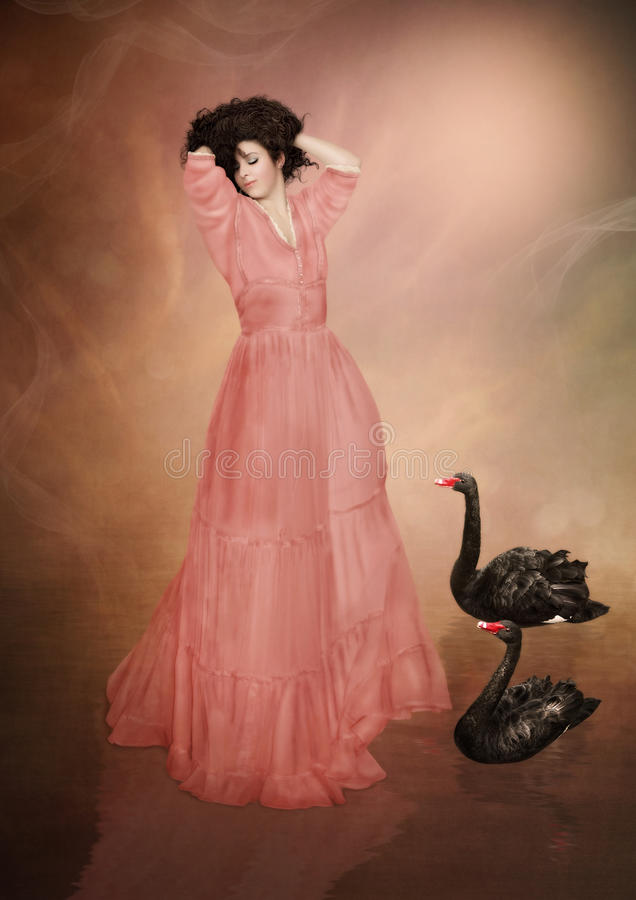 Girl and black swans stock image