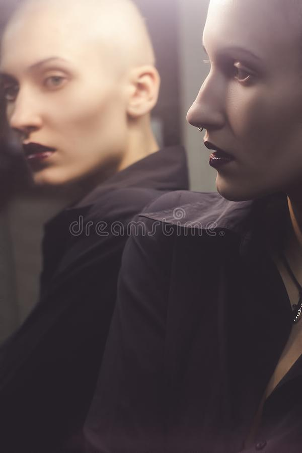 Bold girl in mirror stock images