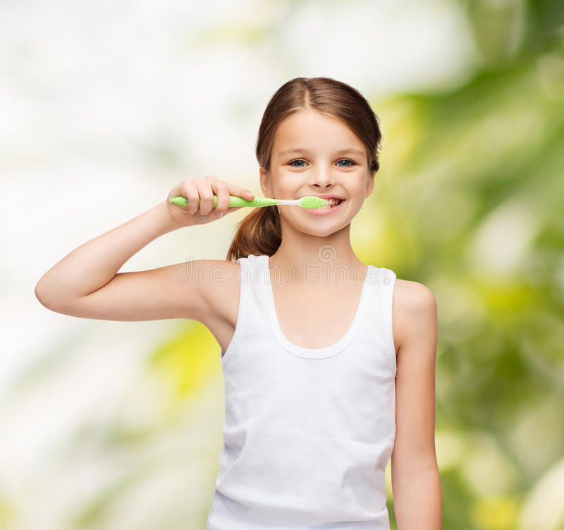 Girl in blank white shirt brushing her teeth stock images