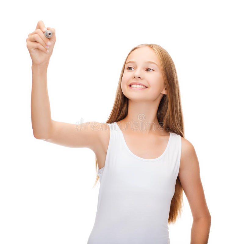 Girl in blank white shirt drawing something. Shirt design concept - smiling teenage girl in blank white shirt drawing or writing something in the air stock photography