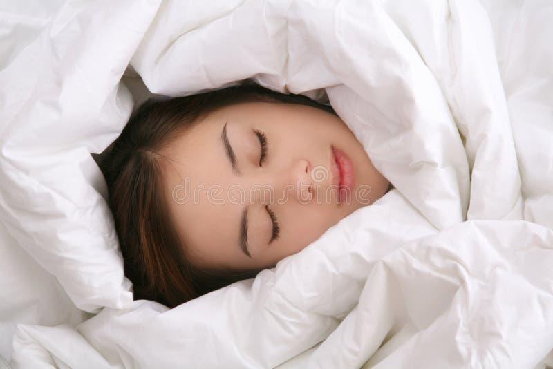 Girl in Blanket Sleeping royalty free stock photos