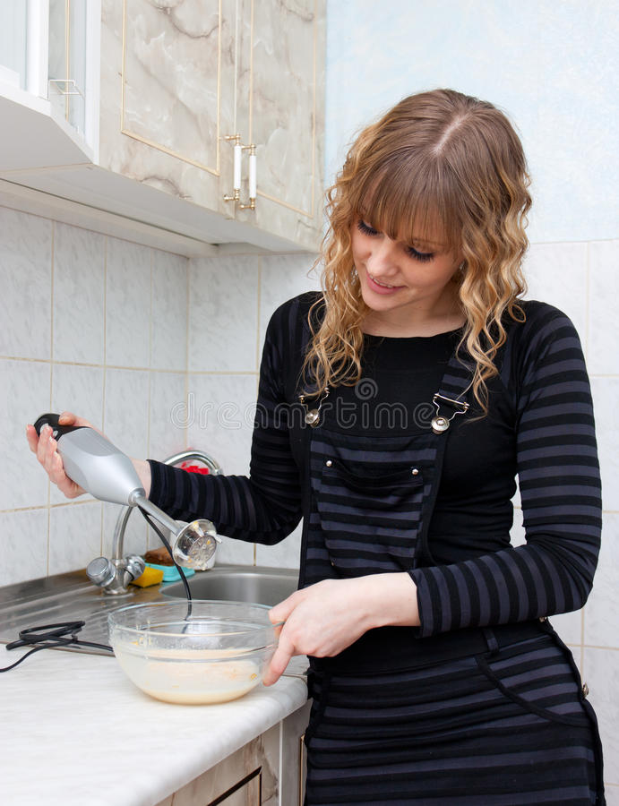 The girl with a blender stock photos
