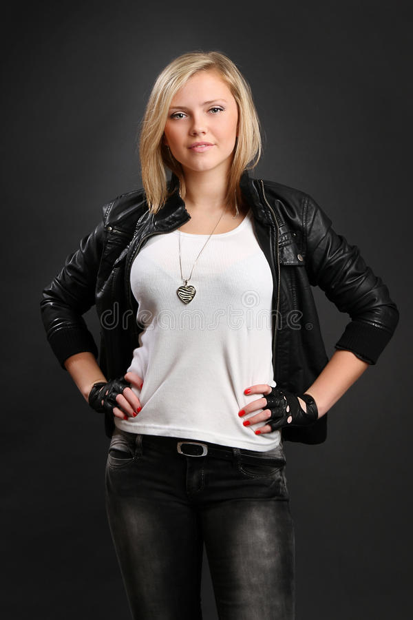 Girl with blond hair dressed in black leahter royalty free stock image