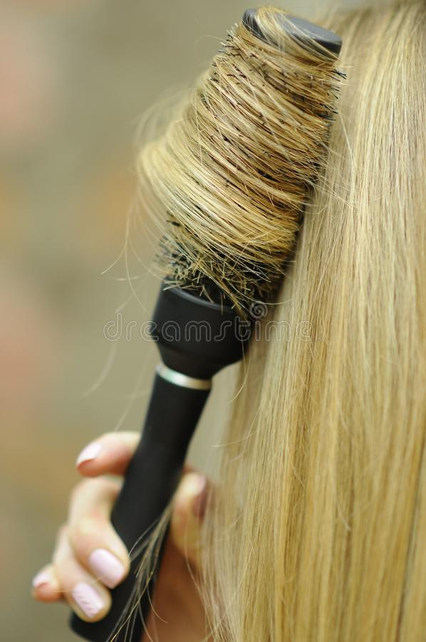 Girl with blond long hair, professional hair styling royalty free stock image