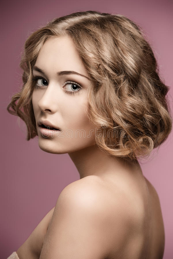 Girl with blonde curly hair-cut royalty free stock image