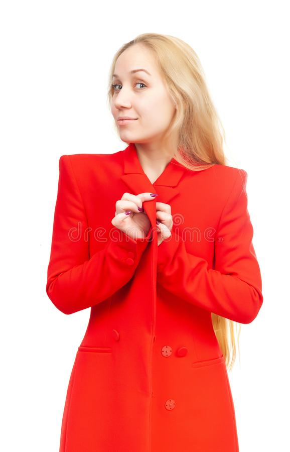 Girl blonde with a flirty expression in red clothes on a white background royalty free stock photos