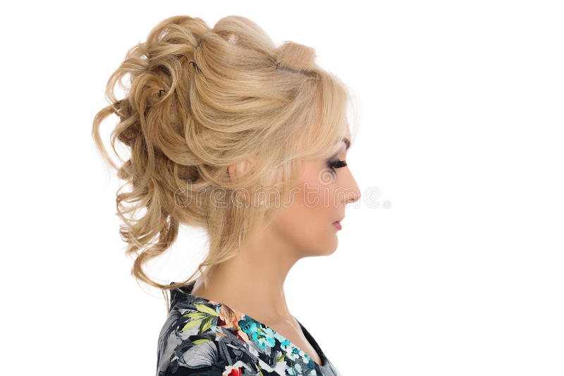 Girl blonde hairstyle model shows in profile stock photography