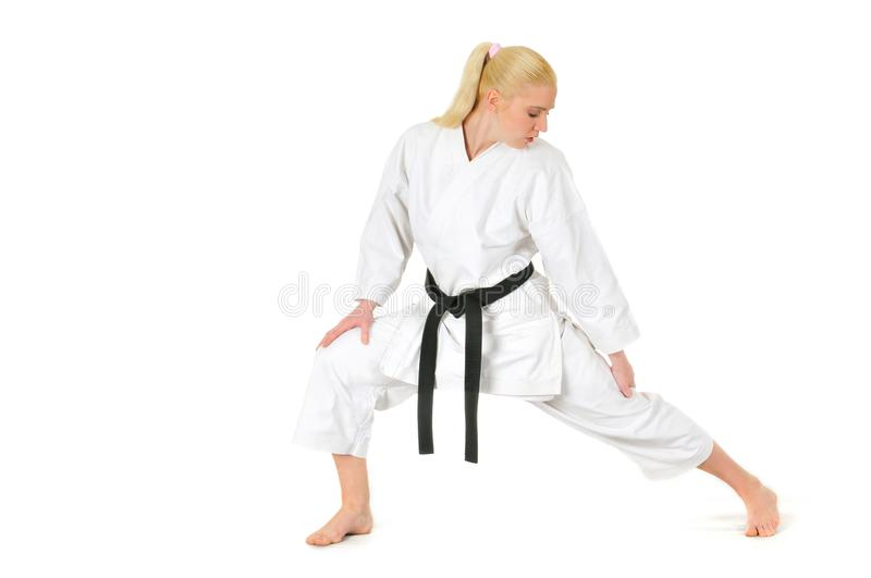 Girl blonde karate sportswoman in a kimono stock photos