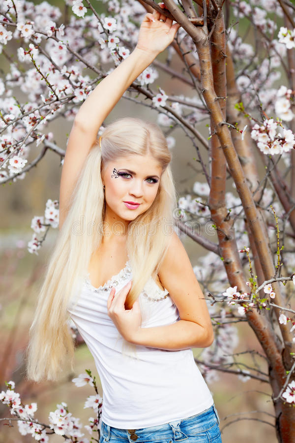 Girl in blossom garden royalty free stock images