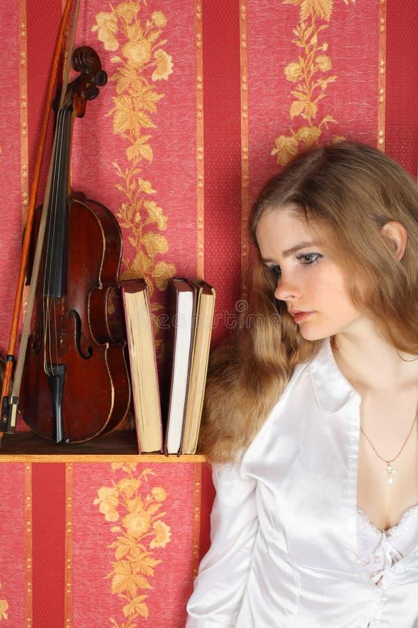 Girl In Blouse In Room Near Violin Stock Photo