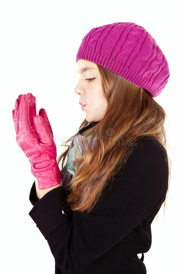 Girl blow on numb hands isolated over white royalty free stock photography