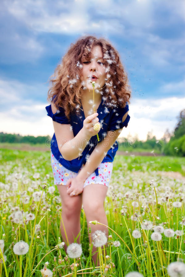 Download Girl blowing a dandelion stock photo. Image of face, bouquet - 14434756
