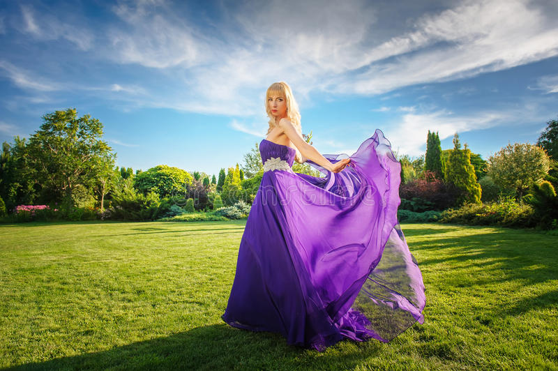 Girl in blowing dress Outdoors royalty free stock photo