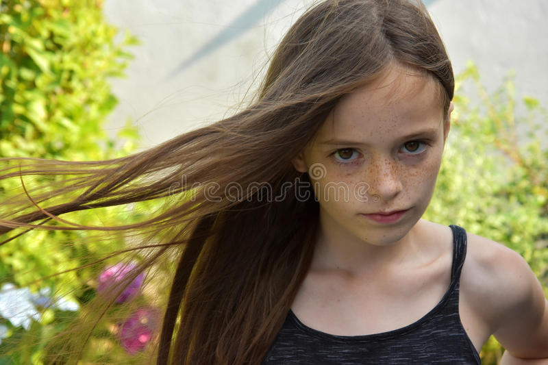 Girl with blowing hair stock photography