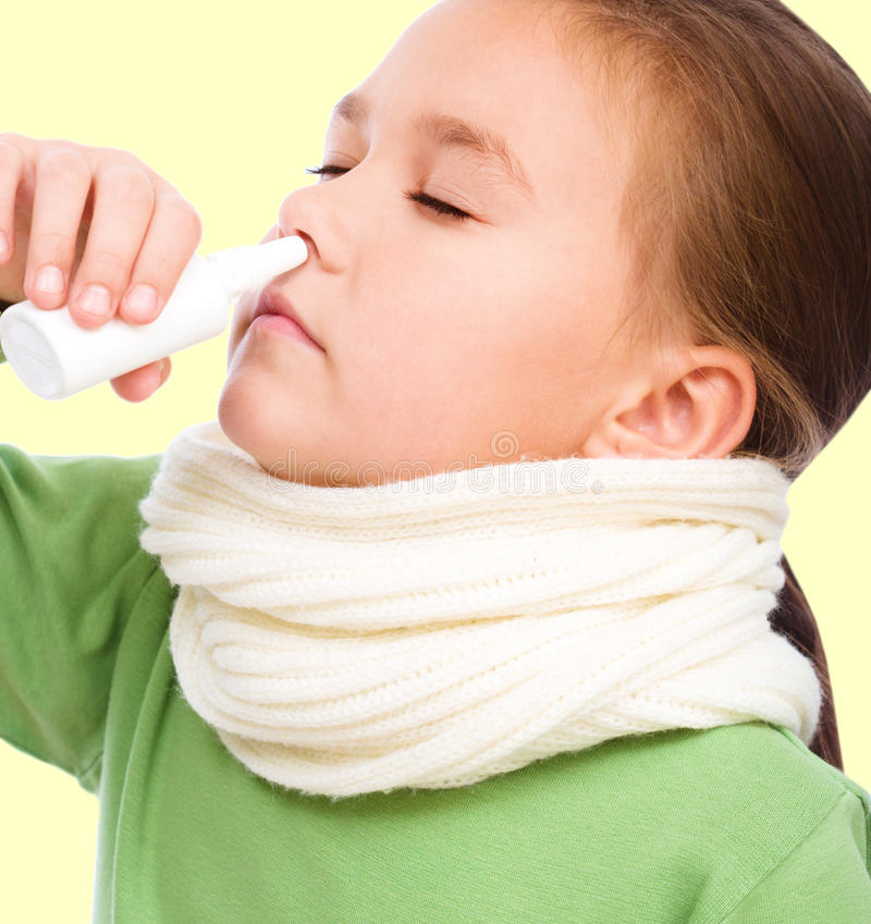 Girl is blowing her nose stock photography
