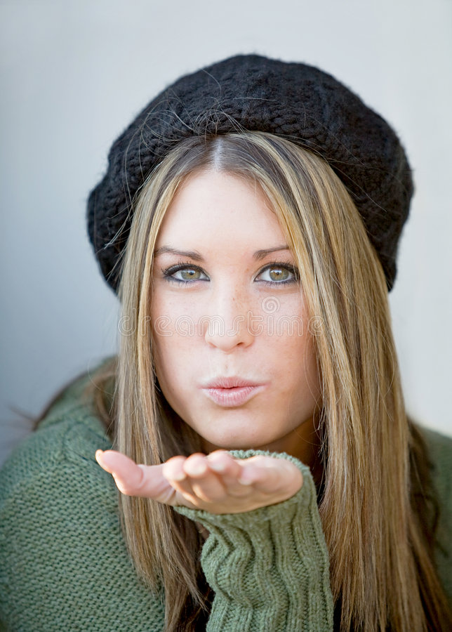 Girl Blowing a Kiss. Teenage Girl in Beret Blowing a Kiss stock photo
