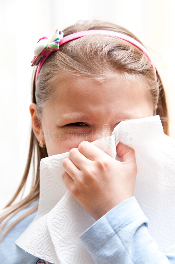Girl blowing nose royalty free stock photos