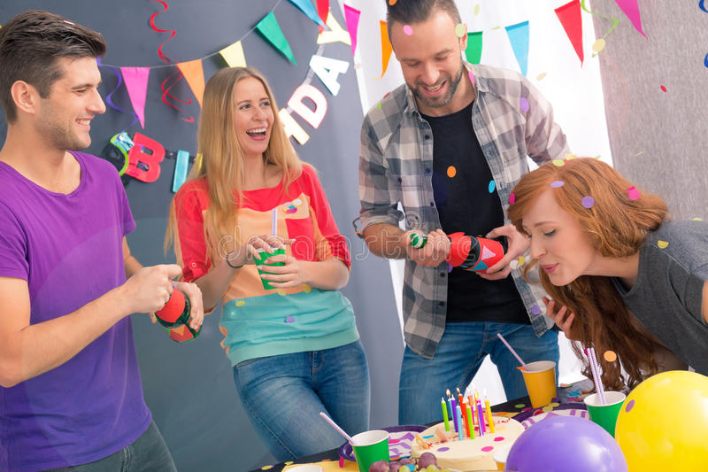 Girl blowing out candles royalty free stock photos