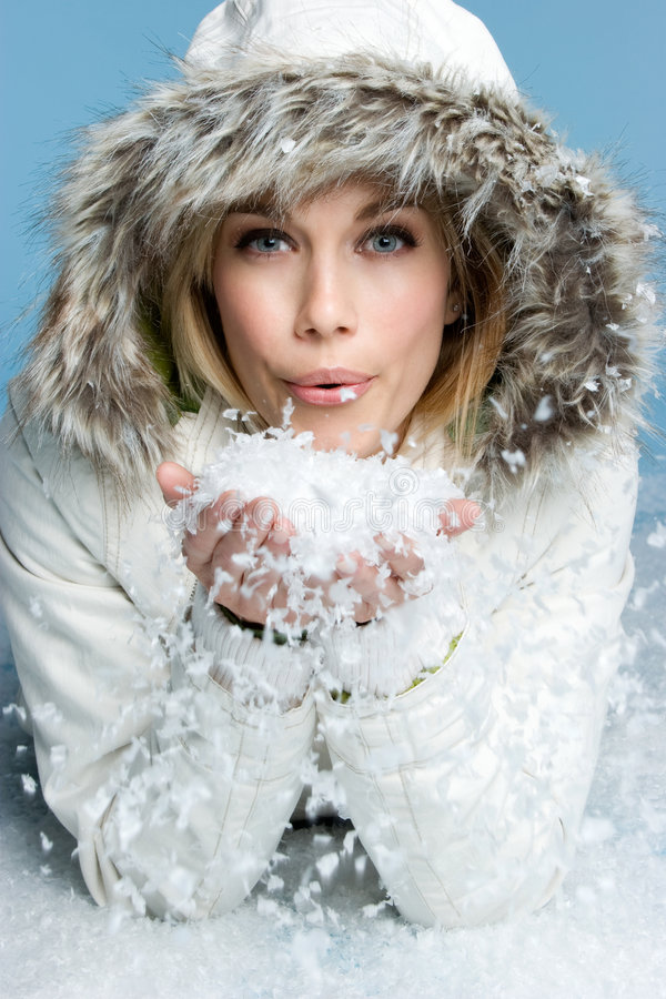 Free Girl Blowing Snow Stock Photo - 7164790