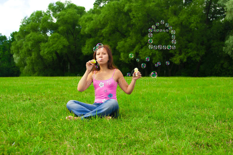 Download Girl blowing soap bubbles stock photo. Image of careless - 24115642