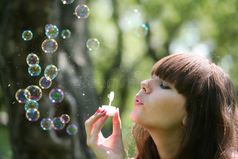 Download Girl blows soap bubbles stock image. Image of sunshine - 10548067