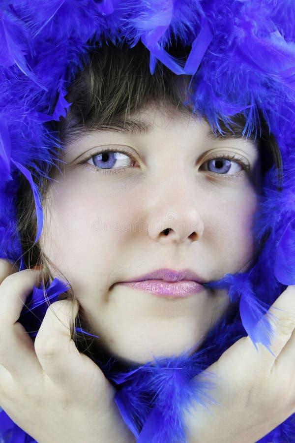 Girl With Blue Boa Stock Photos