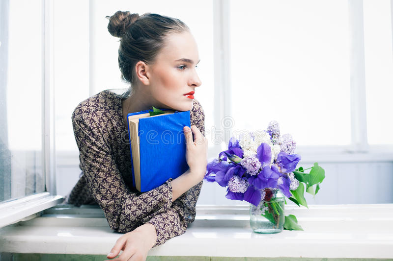 Girl with blue book