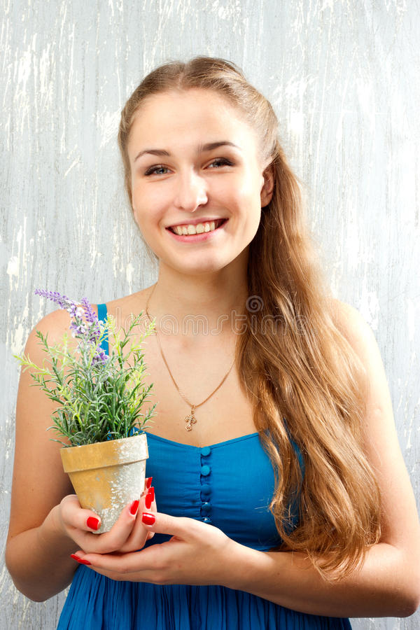 Girl In Blue Clothes With A Flower Stock Images