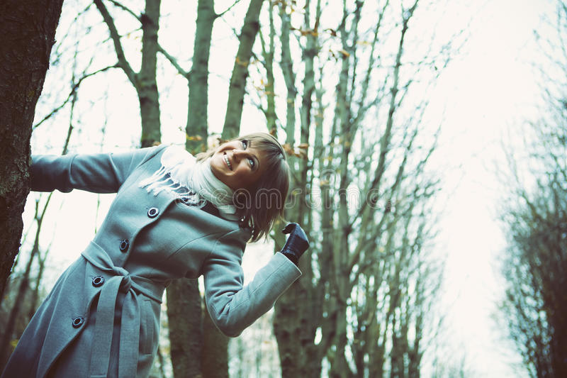 Girl in a blue coat