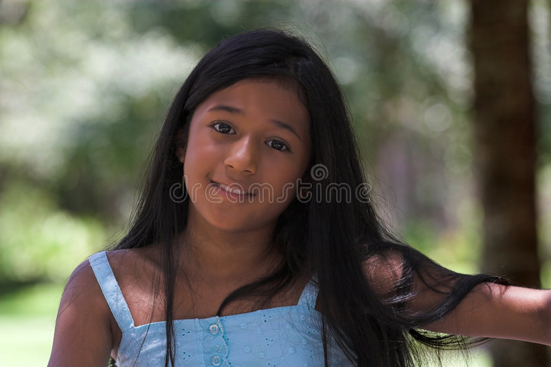Girl in blue dress royalty free stock images