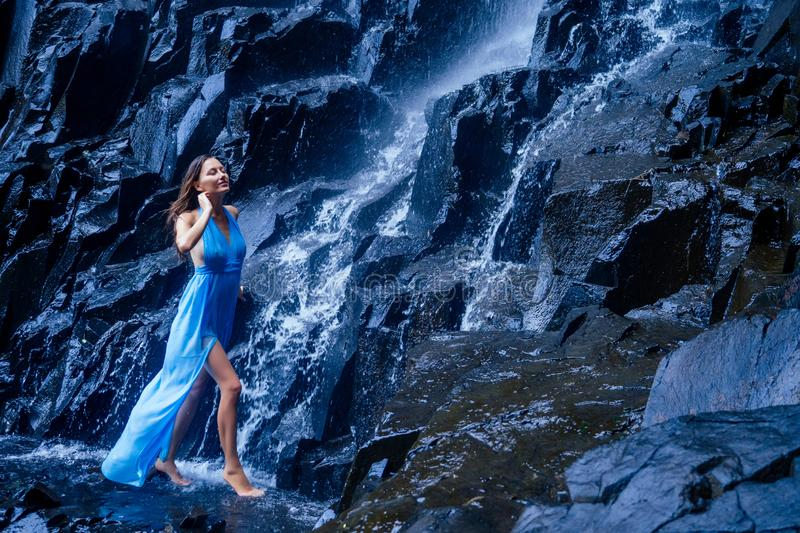 Girl in blue dress at amazing Waterfall india wildernest dudhsagar.  stock images