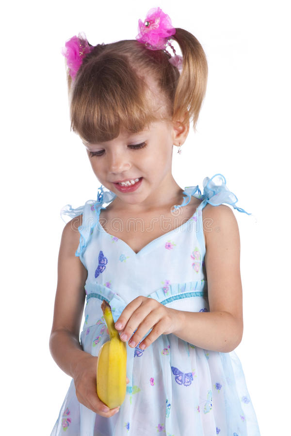 Girl in a blue dress with a banana royalty free stock photo