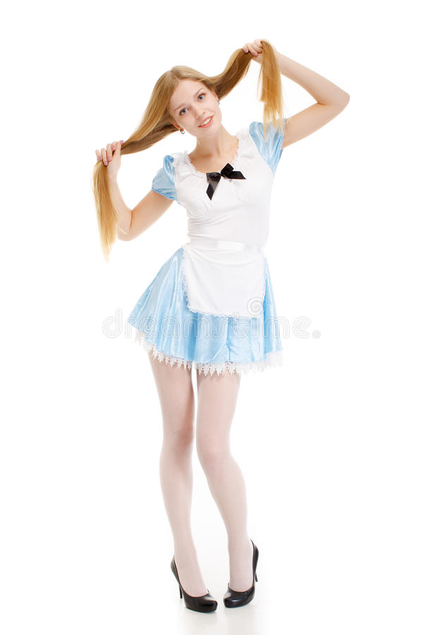 Girl in blue dress with long hair on a white background royalty free stock image