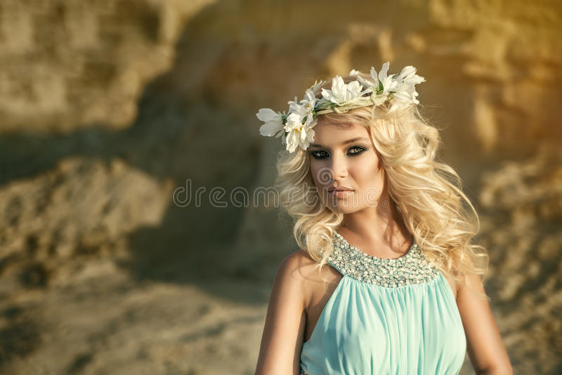 Girl in blue dress with wreath stock photo