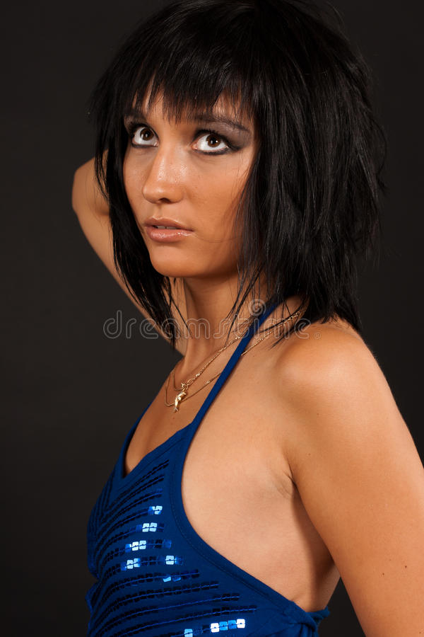 Girl in the blue evening dress stock photo
